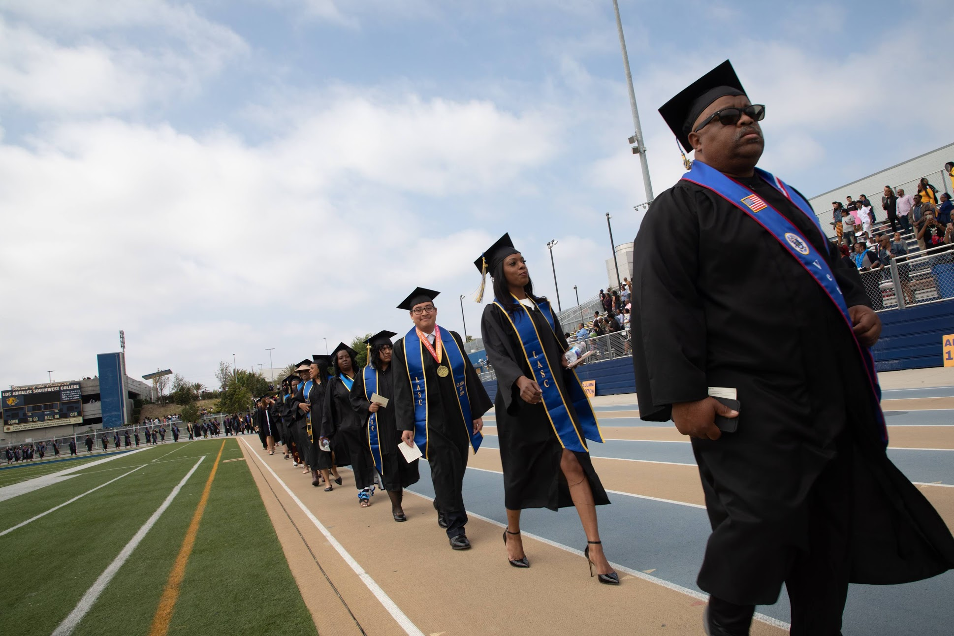 Group of students walking at graduation