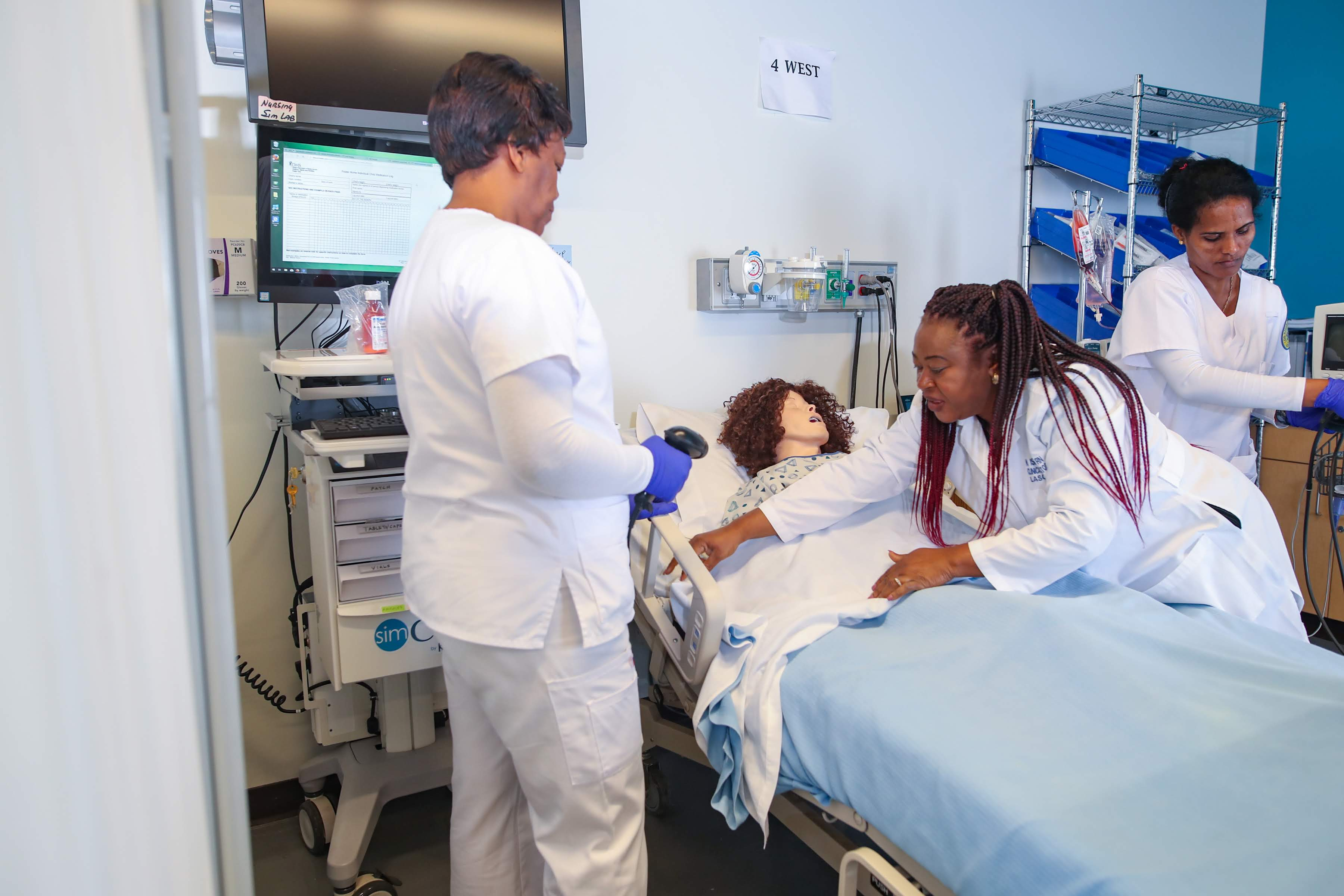 Nursing students practicing on patient